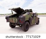 Camouflaged Humvee Truck At...