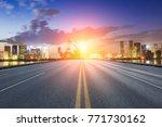 asphalt highway and modern city ... | Shutterstock . vector #771730162