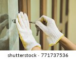Small photo of Burglar with passkey tools breaking and entering into a house