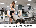 female personal trainer helping ... | Shutterstock . vector #771807778