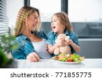 portrait of excited mother and... | Shutterstock . vector #771855775