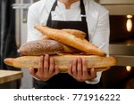 baker is showing breads made by ... | Shutterstock . vector #771916222