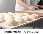 raw loaves of bread on table in ... | Shutterstock . vector #771919252