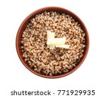bowl with cooked buckwheat on... | Shutterstock . vector #771929935