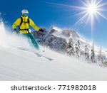 skier on piste running downhill ... | Shutterstock . vector #771982018