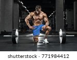 muscular man working out in gym ... | Shutterstock . vector #771984412