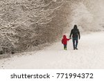 father walks with his little... | Shutterstock . vector #771994372