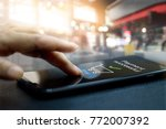 hand touching mobile screen of... | Shutterstock . vector #772007392