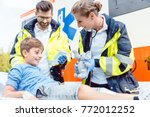 emergency medic giving soft toy ... | Shutterstock . vector #772012252