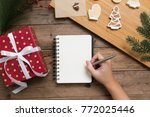 female hands writing in open...   Shutterstock . vector #772025446