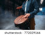 Male Drummer Playing On Wooden...