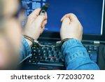 close up. arrested hacker man... | Shutterstock . vector #772030702
