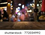 empty wood table top and blur... | Shutterstock . vector #772034992