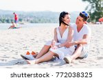 romantic young couple sitting... | Shutterstock . vector #772038325