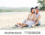 romantic young couple sitting... | Shutterstock . vector #772038328