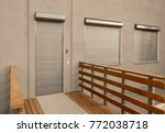 light brown metal blinds on the ... | Shutterstock . vector #772038718