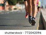 marathon runners running on... | Shutterstock . vector #772042096