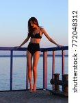 silhouette young woman relaxing ... | Shutterstock . vector #772048312