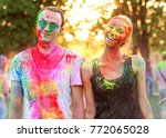 guy with a girl celebrate holi... | Shutterstock . vector #772065028