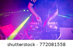 dj with headphones playing... | Shutterstock . vector #772081558