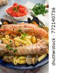 "Small photo of Italian pasta ""Penne allo scoglio""."