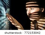 portrait  beautiful girl  looks ... | Shutterstock . vector #772153042