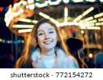 red haired girl in christmas ... | Shutterstock . vector #772154272