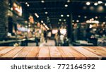 wood table top  bar  with blur... | Shutterstock . vector #772164592