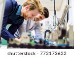 two young handsome engineers... | Shutterstock . vector #772173622