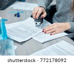 girl puts a stamp on documents... | Shutterstock . vector #772178092
