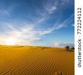 sandy desert at the sunset | Shutterstock . vector #772224112