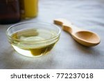 liquid coconut mct oil in round ... | Shutterstock . vector #772237018