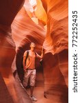 Young man exploring Antelope Canyon in the Navajo Reservation near Page, Arizona USA. Beautiful life. Amazing orange caves and cliffs in Arizona.