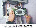 engineer adjusting thermostat...   Shutterstock . vector #772266772