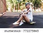 beautiful brunette skater girl... | Shutterstock . vector #772275865