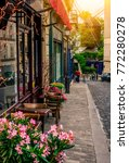 cozy street with tables of cafe ... | Shutterstock . vector #772280278