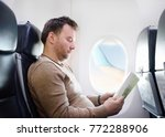 middle age man traveling by an... | Shutterstock . vector #772288906