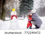 little boy with his mother... | Shutterstock . vector #772290472