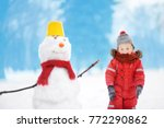 little boy in red winter... | Shutterstock . vector #772290862