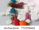 colorful pills closeup on white ... | Shutterstock . vector #772298662