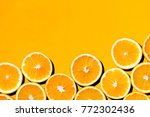 sliced orange against colorful... | Shutterstock . vector #772302436