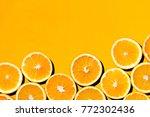 sliced orange against colorful... | Shutterstock . vector #772302436