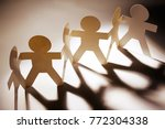 team of paper chain people in a ... | Shutterstock . vector #772304338