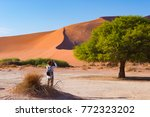 tourist taking photo at... | Shutterstock . vector #772323202