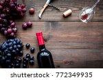 open wine bottle. grape and... | Shutterstock . vector #772349935
