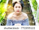 portrait hopefully beautiful...   Shutterstock . vector #772355122