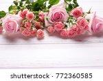 border from tender pink roses...   Shutterstock . vector #772360585