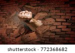 hand breaking through the wall. ... | Shutterstock . vector #772368682