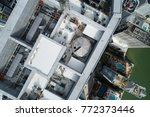 aerial highrise rooftop... | Shutterstock . vector #772373446