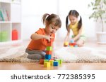 kids children playing block... | Shutterstock . vector #772385395